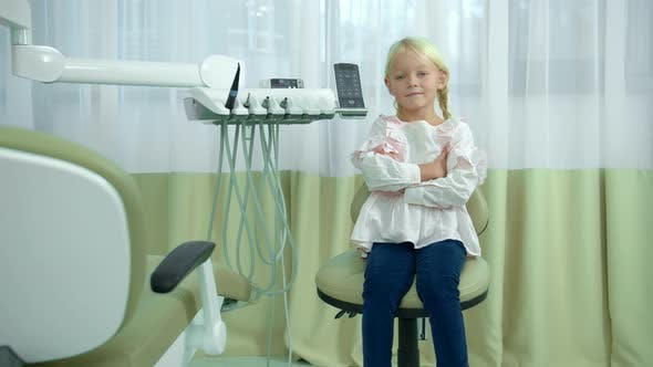 Thumbnail for Little Girl Sit with Hand on Hand in Dental Chair