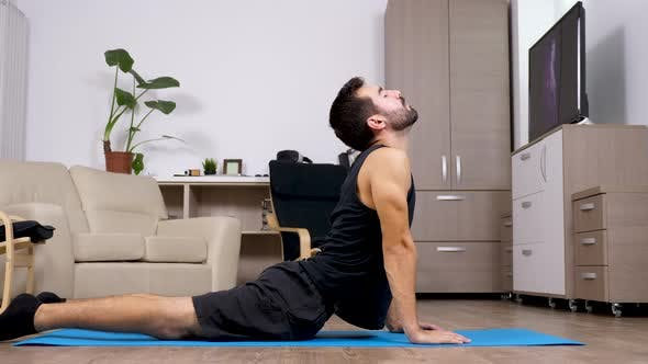 Thumbnail for Fit Man Does Different Yoga Poses