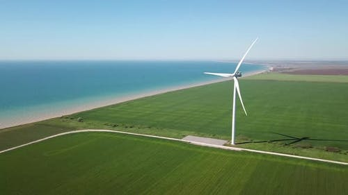Wind power station on the field. Concept and idea of alternative energy development