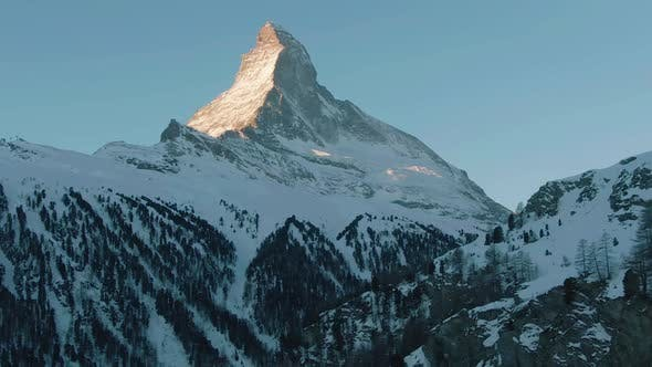 Thumbnail for Matterhorn Mountain and Forest in Winter Morning. Swiss Alps. Switzerland. Aerial View