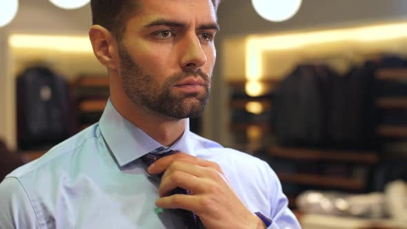 Thumbnail for Man Tying a Tie at Wear Clothing Store