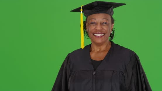 Thumbnail for An older black woman graduating college on green screen