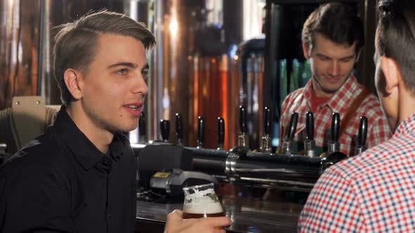 Thumbnail for Attractive Young Man Enjoying Drinking Beer with His Friend