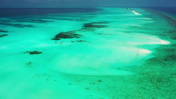Thumbnail for Aerial above landscape of beautiful island beach trip by aqua blue ocean with white sandy background