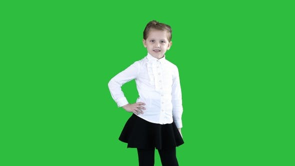 Thumbnail for Little smiling girl in white poses on a Green Screen, Chroma Key.