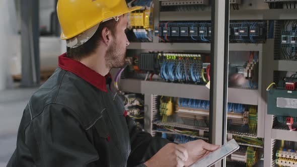 Electrician Installing Electric Panel