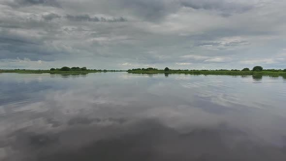 Thumbnail for Flying Over Lake Surface with Reflection of Sky