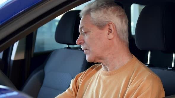 Thumbnail for Senior Man Shows Car Key Through the Window