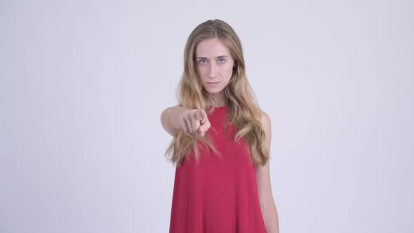 Thumbnail for Young Serious Blonde Woman Pointing at Camera