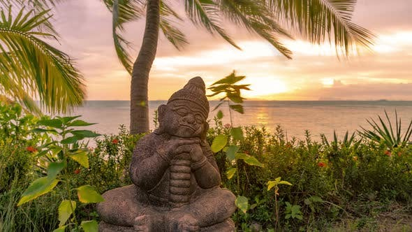 Cover Image for Little Buddha statue beside the sea at the sunset time in Koh Samui, Thailand