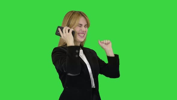 Thumbnail for Happy Business Woman Enjoy Success on Mobile Phone on a Green Screen, Chroma Key.