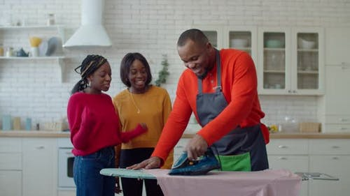 Happy Single Parent Family Enjoying Household Chores