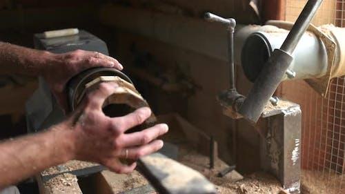 Carpenter Making Wooden Mug