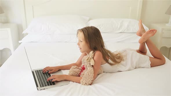 Thumbnail for Cute Little Girl Doing Homework on Laptop
