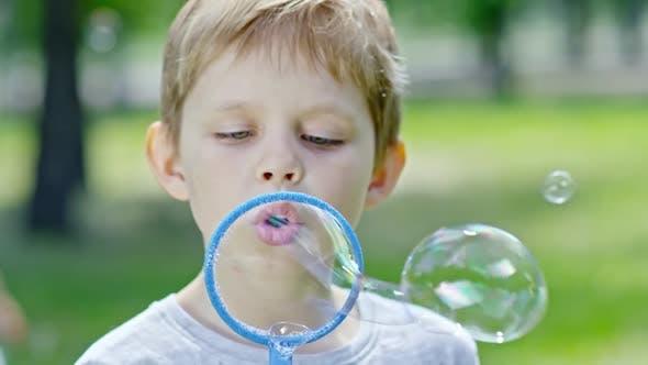 Thumbnail for Little Boy Enjoying Blowing Bubbles