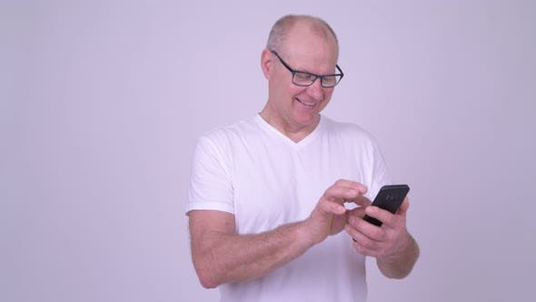 Thumbnail for Happy Handsome Senior Man Using Phone