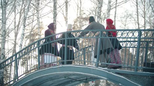Russian Folklore - Four Men and Four Women Are Dancing on a Bridge