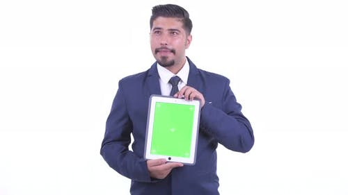 Happy Bearded Persian Businessman Thinking While Showing Digital Tablet