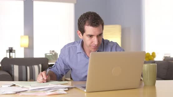 Thumbnail for Man handling personal finances at desk