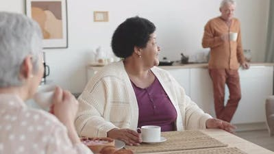 Senior Friends Having Discussion Over Tea