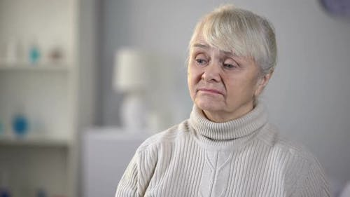 Unhappy Senior Woman in Nursing Home Feeling Depressed and Forgotten, Loneliness