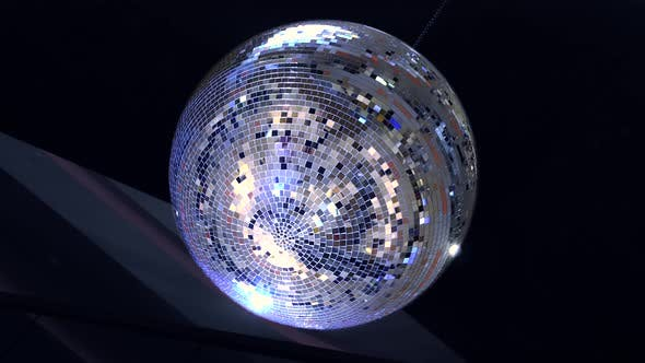 Thumbnail for Rotating Sparkling Disco Ball, Mirror Disco Ball Reflecting Blue Lights on Black Background, Night