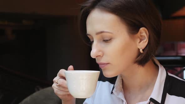 Thumbnail for Young Attractive Business Lady Drinking Coffee in Cozy Restaurant