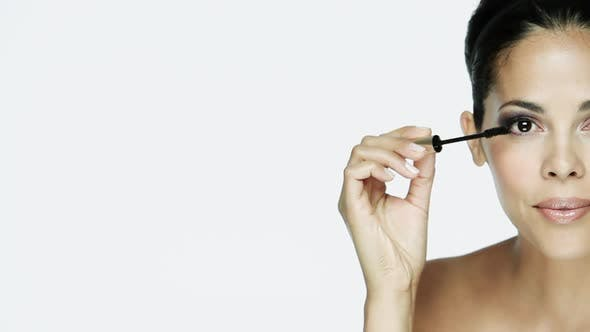Thumbnail for Woman applying mascara