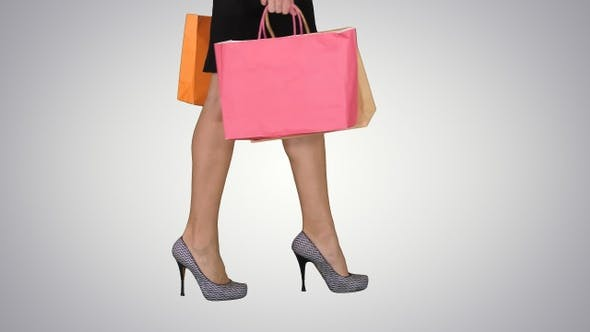 Thumbnail for Walking Legs of Shopping Lady with Shopping Bag on Gradient