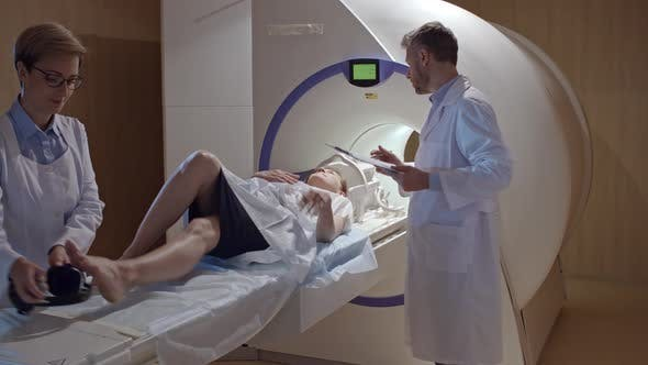 Thumbnail for Radiologist Preparing Patient for MRI Scan
