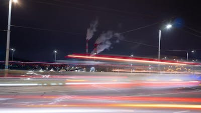A busy intersection and smoking chimneys, Vilnius, Lithuania, time-lapse
