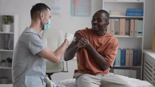 Man and Doctor Bumping Fists