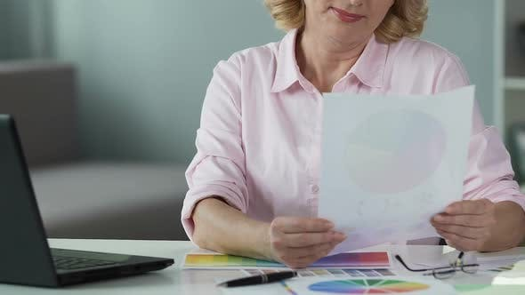 Thumbnail for Interior Designer Choosing Color on Paper and Looking on Laptop Screen, Close-Up