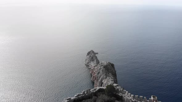 Castle ruins and rocks in sea, aerial view