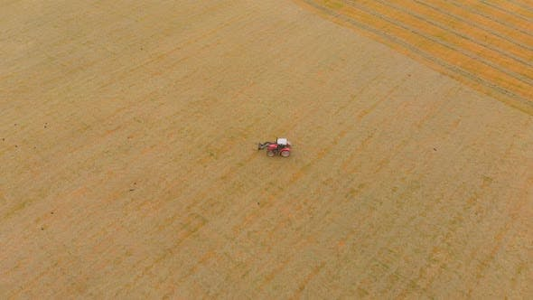 Thumbnail for Tractor moving on agricultural field 4k
