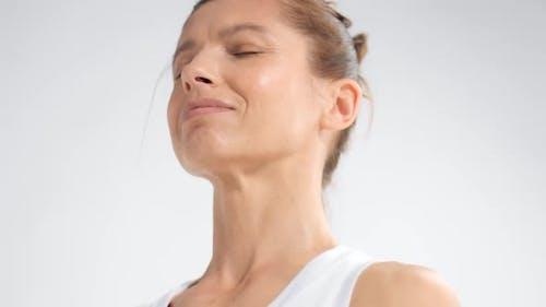 Senior Woman in White Space Practice Yoga Closeup Portrait