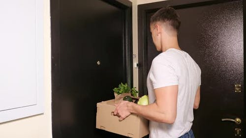 Delivery Guy Gives Paper Box with Fresh Vegetables To Client