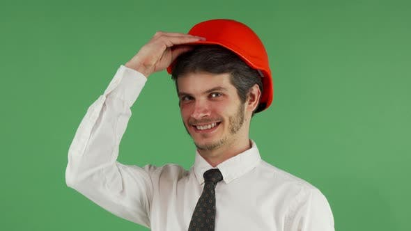 Cover Image for Cheerful Male Engineer Smiling Putting on His Hardhat