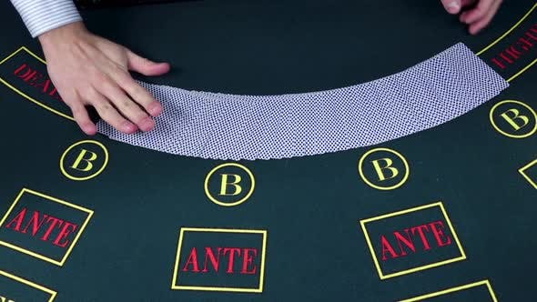 Thumbnail for Croupier Dealing Cards in a Poker Game Table, Slow Motion