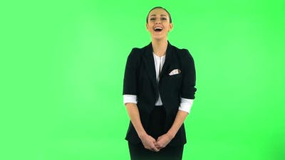 Girl Listens Carefully Then Bursts Into Laughter. Green Screen