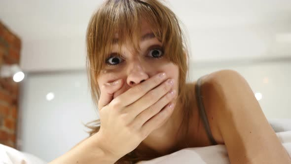 Wondering Woman Lying in Bed, Shock, Astonished