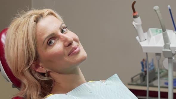Thumbnail for Beautiful Mature Woman Smiling Joyfully Sitting in Dental Chair