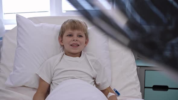 Thumbnail for Cute Boy Shaking Hands with Doctor in Hospital Ward