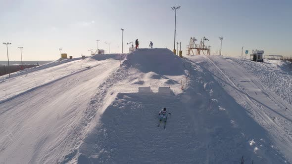 Thumbnail for Mogul Skiing, Downhill From the Mountains