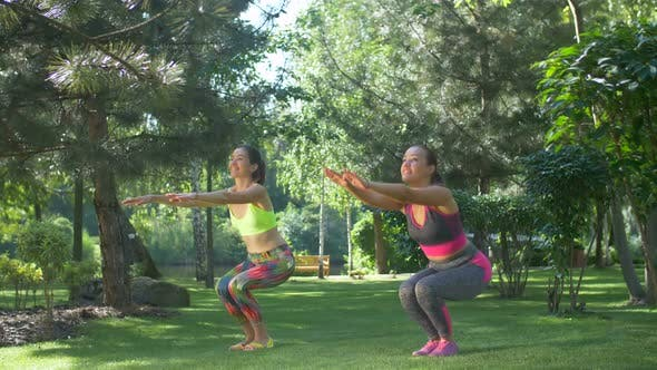 Thumbnail for Pretty Sporty Fitness Women Doing Squats in Nature