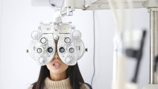 Woman check on eye in clinic