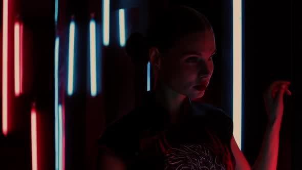 Thumbnail for Sensual Woman Under Neon Illumination
