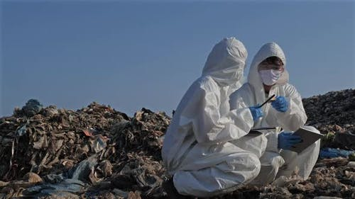 Scientist checking waste will be dumped in landfill