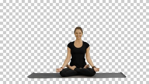 Young woman meditates while practicing yoga, Alpha Channel
