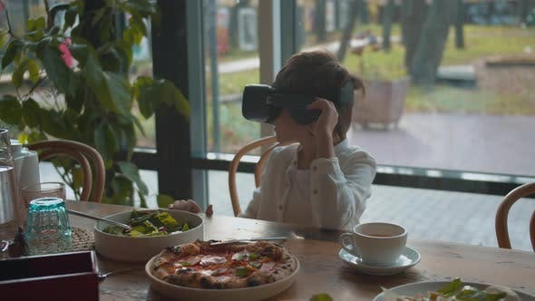 Thumbnail for Boy Looking Around in Virtual Reality Glasses at Lunch